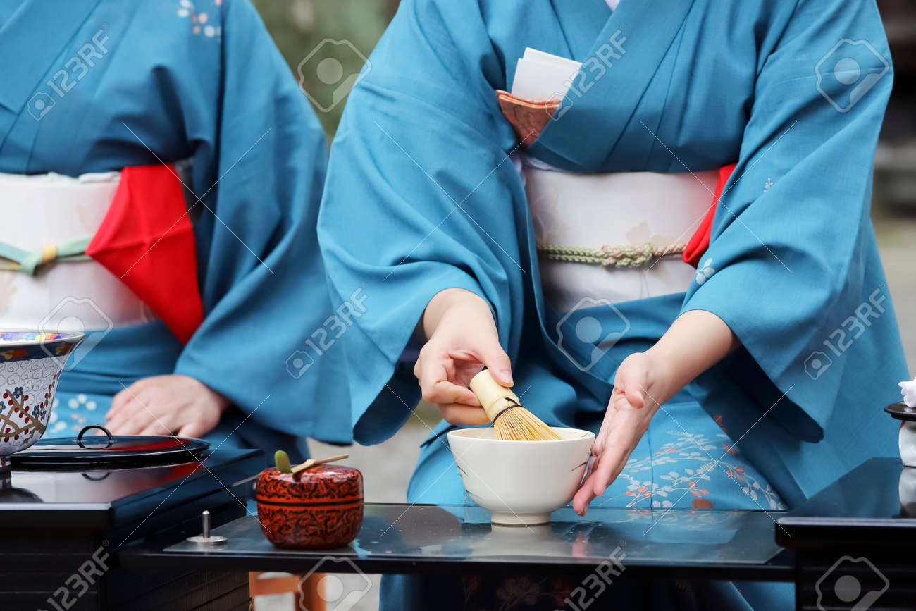 Japanese woman in traditional kimono preparing japanese green tea ceremony at garden - 108962713