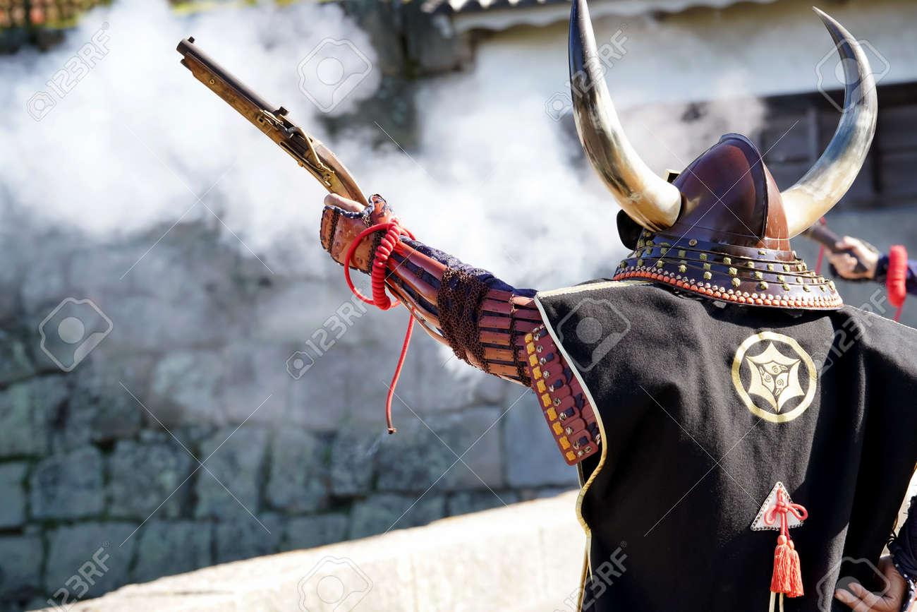 Japanese Samurai Clothing Yoroi And Kabuto Uniform With Old Rifle Stock Photo Picture And Royalty Free Image Image 118420886