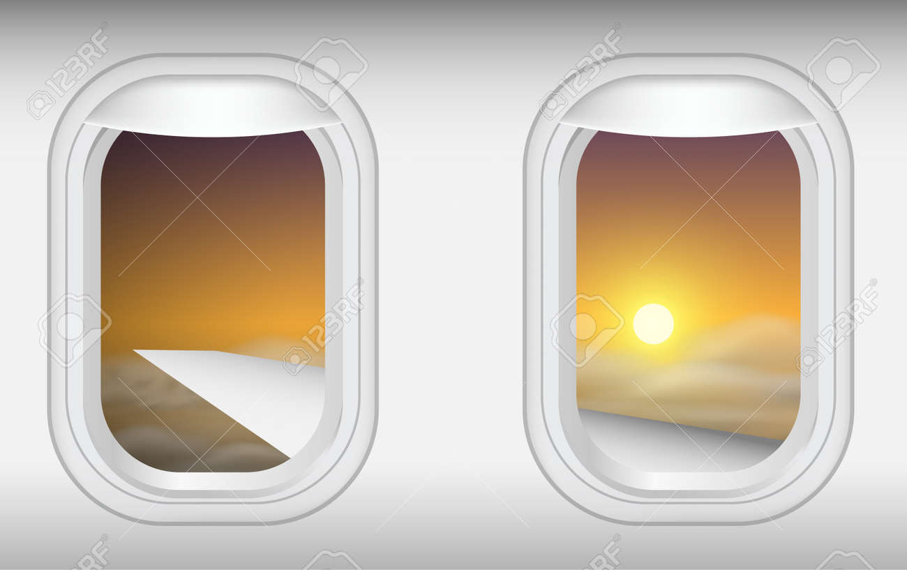 view of windows of plane in on the sky in the morning - 128510478