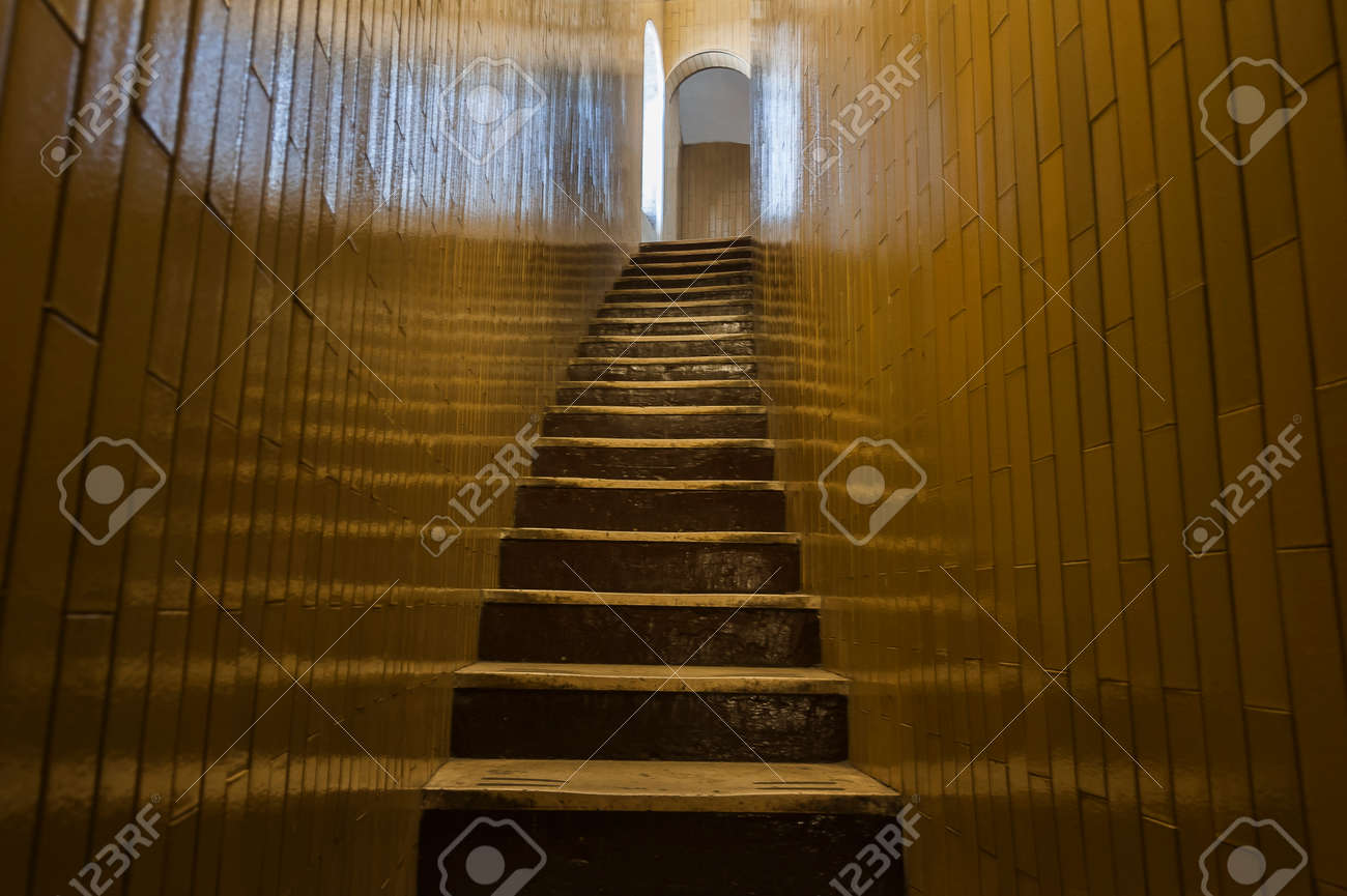 Stone Narrow Staircase Goes Up Between Two Walls Stock Photo