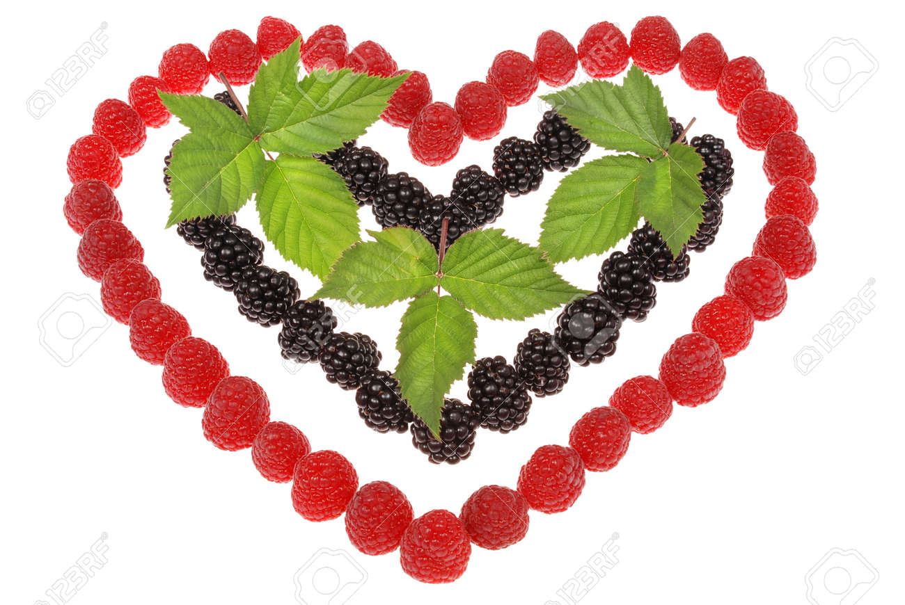 Heart made out of raspberries and blackberries. Top leaves of blackberry. On white background Stock Photo - 11721324