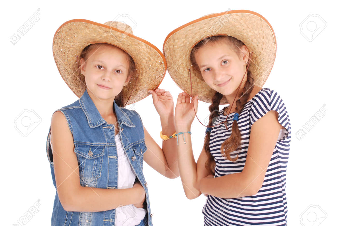 7de4a811ccb Stock Photo - Two pretty twelve year old girls wearing a big floppy straw  sun hat isolated on white