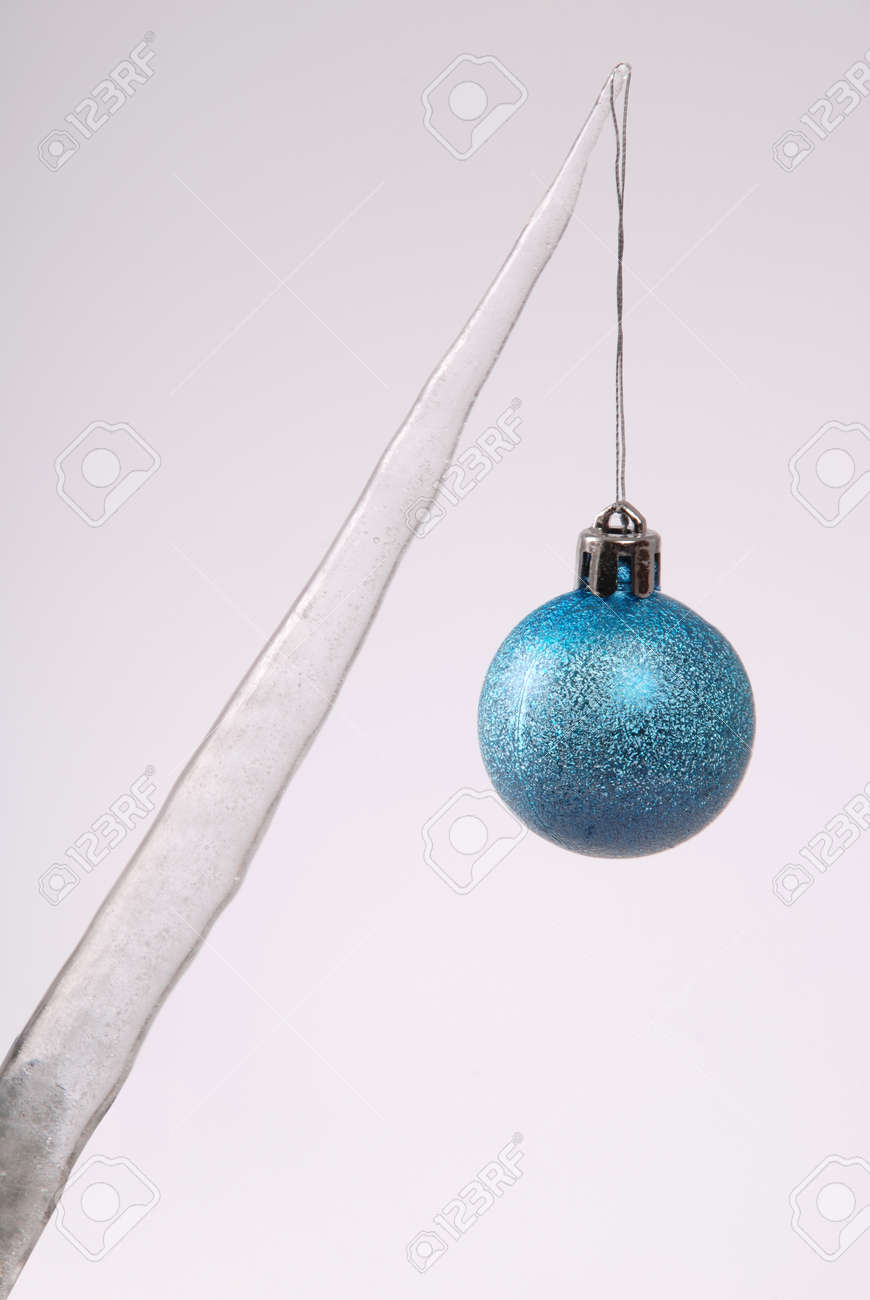 Icicle With A Christmas Tree Toy Isolated On A Grey Background ...