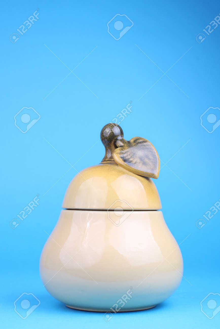 cup sugar-bowl in the form of a pear isolated on blue background Stock Photo - 13404766