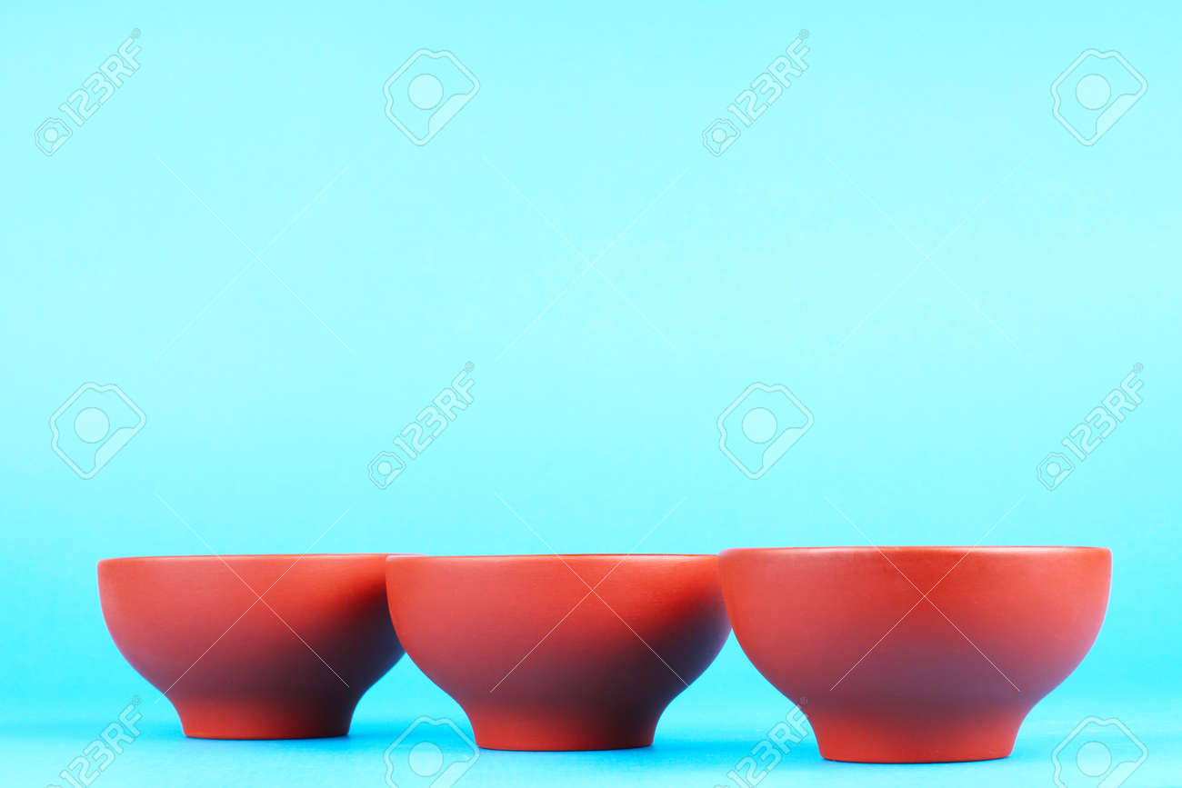 Arabian old ceramic brown teacups isolated on blue Stock Photo - 13657704