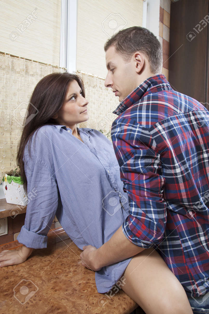 Portrait of a young couple making sex in the kitchen Stock Photo - 16630500
