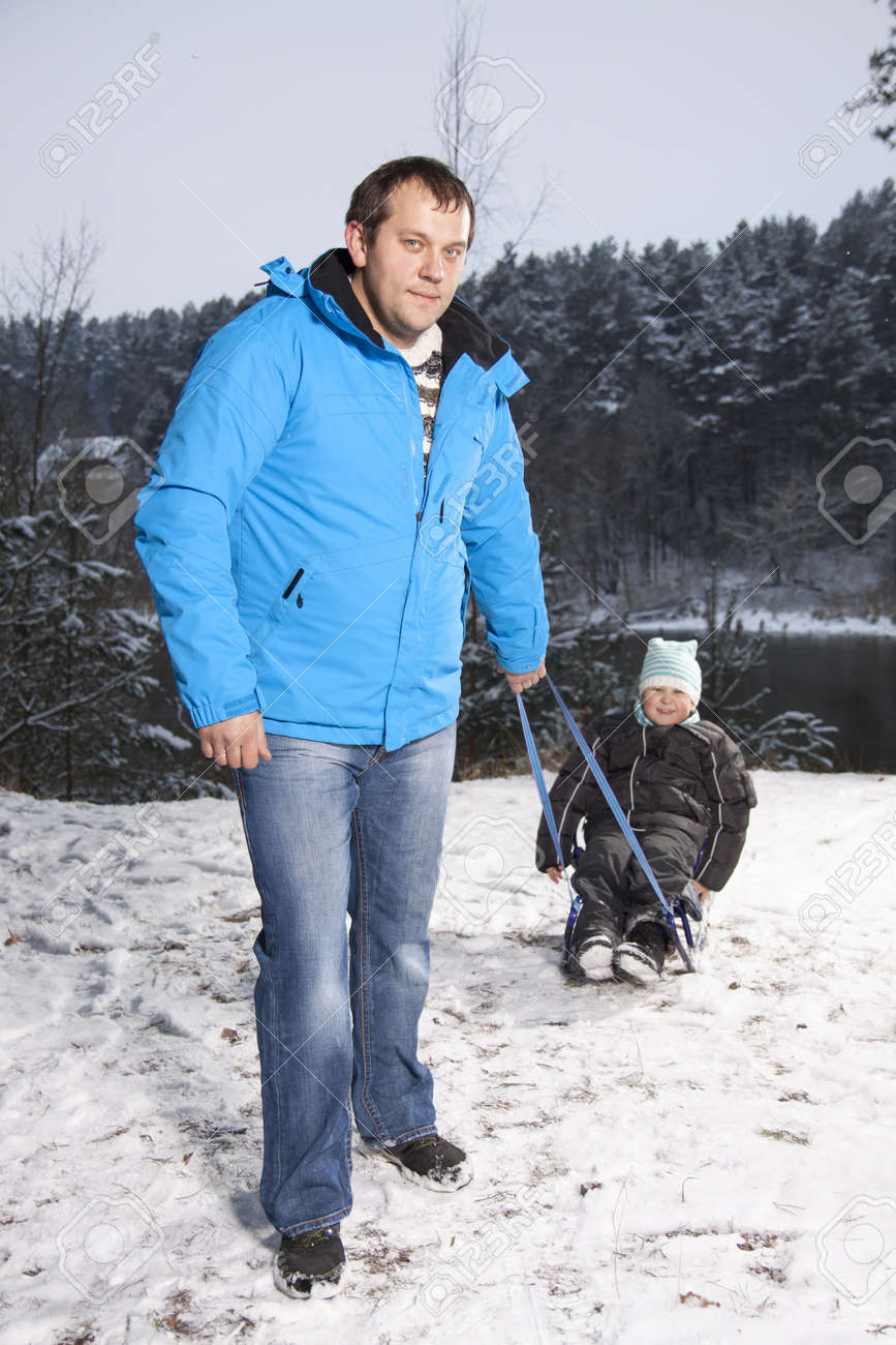 Father and son with a sledge outdoor in the snow Stock Photo - 17007642
