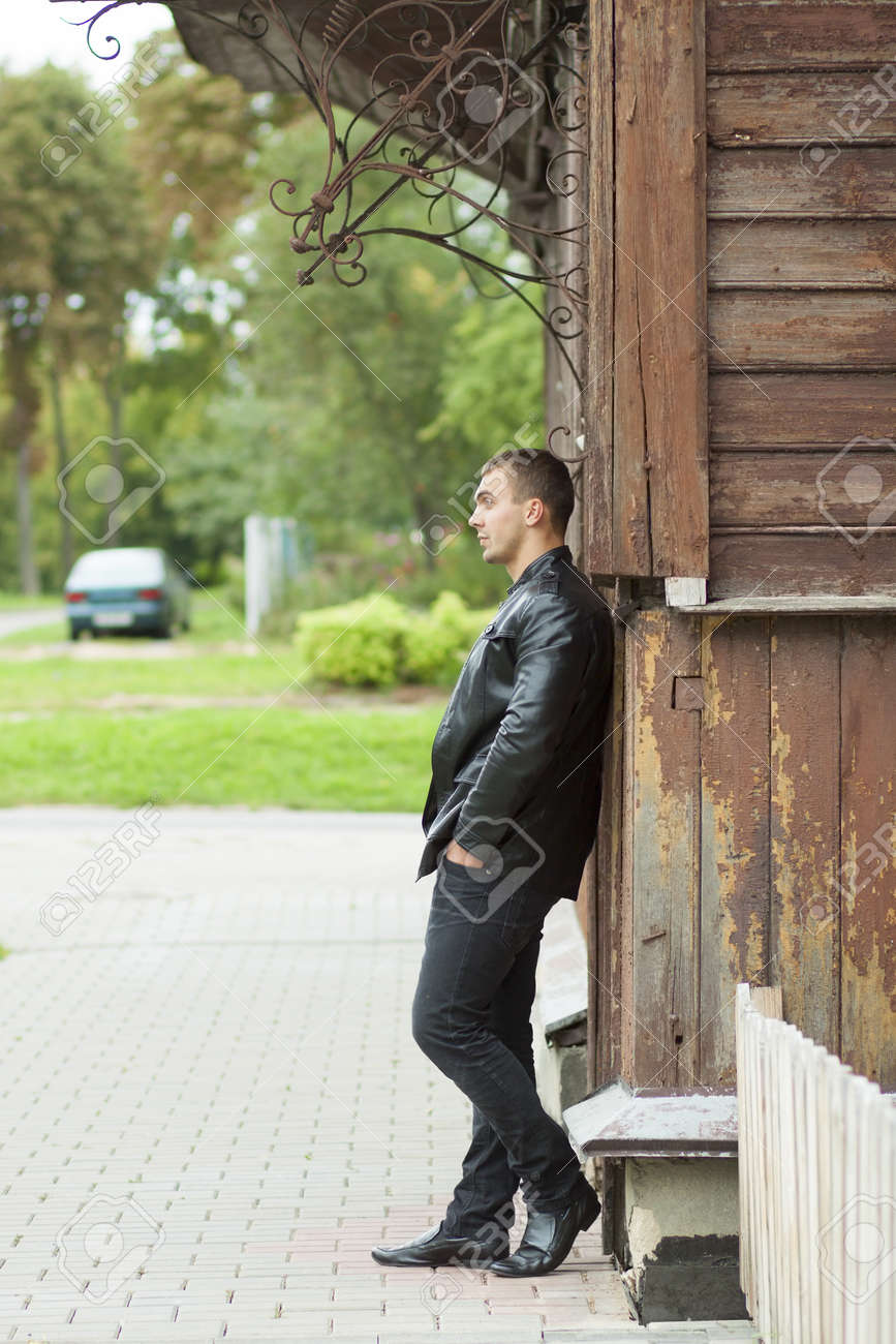 portrait of the brutal young man in a leather jacket Stock Photo - 17193262