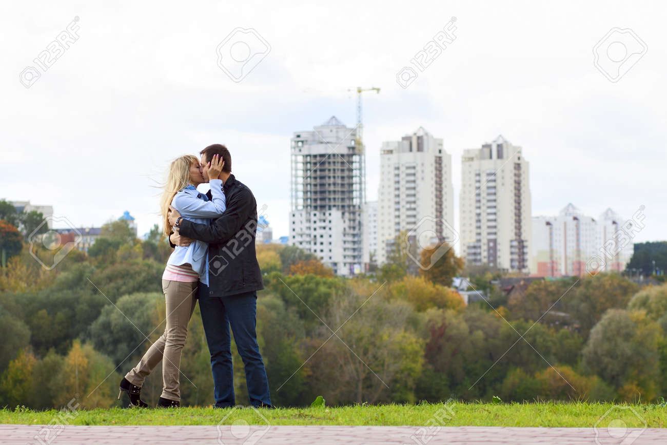 Happy couple kissing against building new brick house Stock Photo - 17700770
