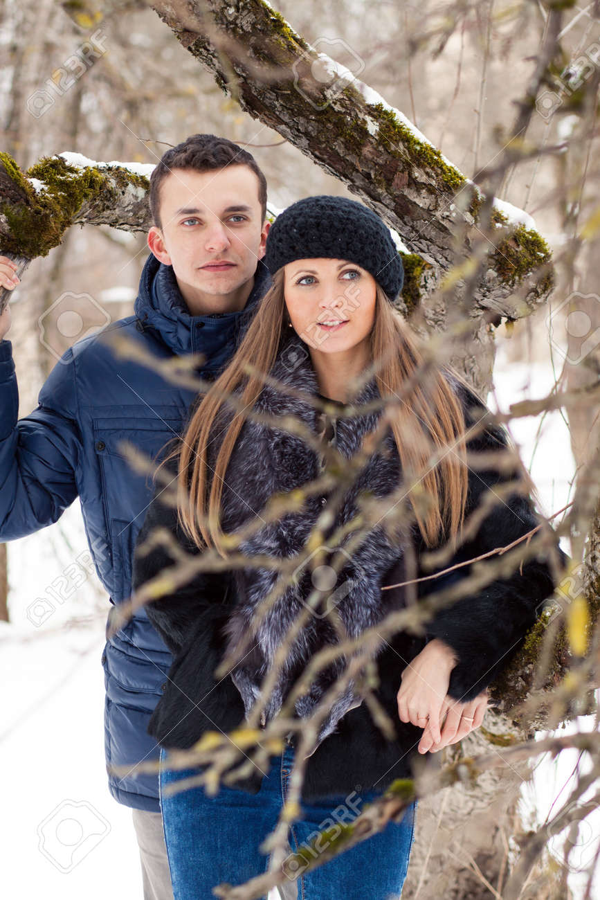 Happy Young Couple in Winter garden kissing. Stock Photo - 18485556