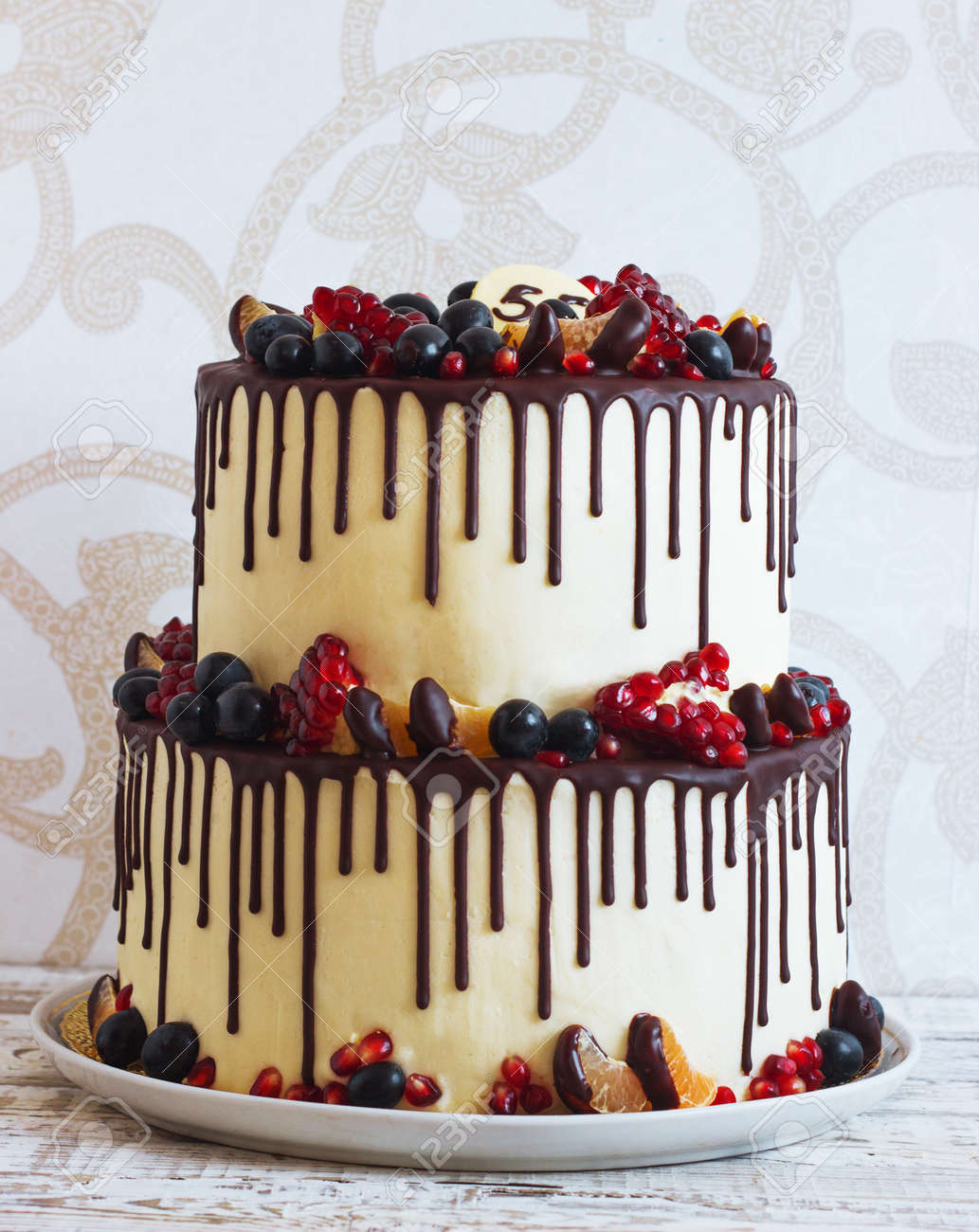 Festive Two Tier Cake With Fruit With Streaks Of Chocolate On Stock Photo Picture And Royalty Free Image Image 66001498