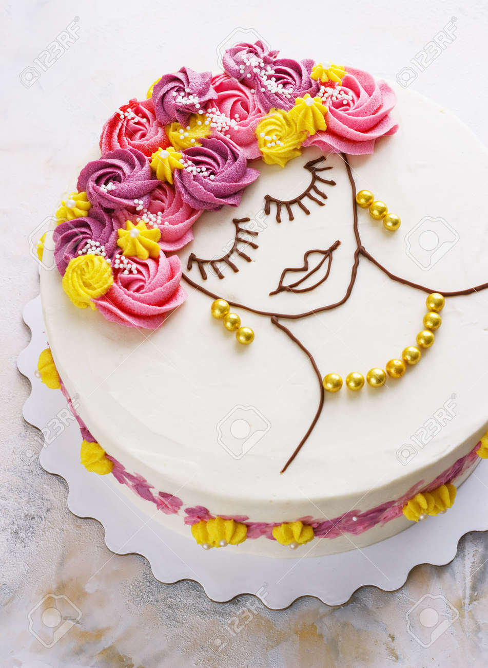 Festive Cake With Cream Flowers And A Girl Face On Light Background Modern
