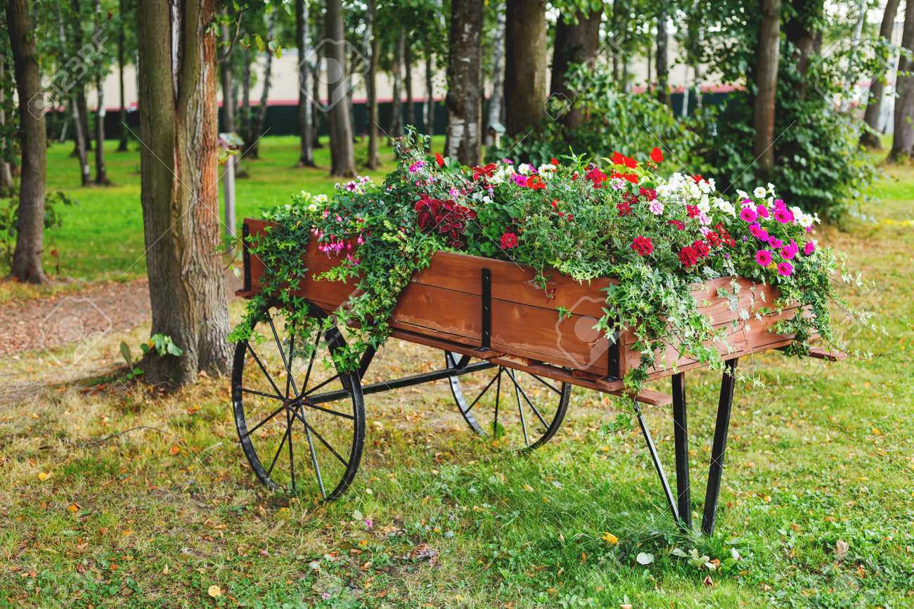 Flowerbed Shaped As A Wooden Cart. Garden Decoration With Petunia ...