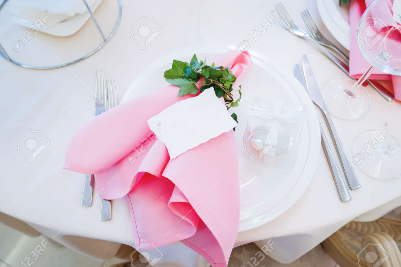Table Set For Wedding Banquet With Cutlery. Ivy Leaves Decoration ...