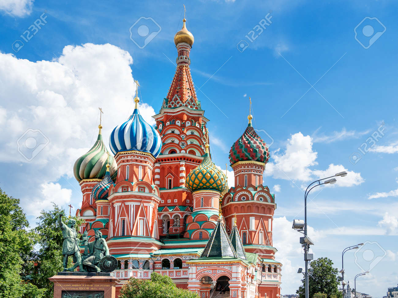 Domes of Saint Basil Cathedral on blue sky background. Monument to Minin and Pozharsky. Famous landmark of Moscow, Russia. - 159641004