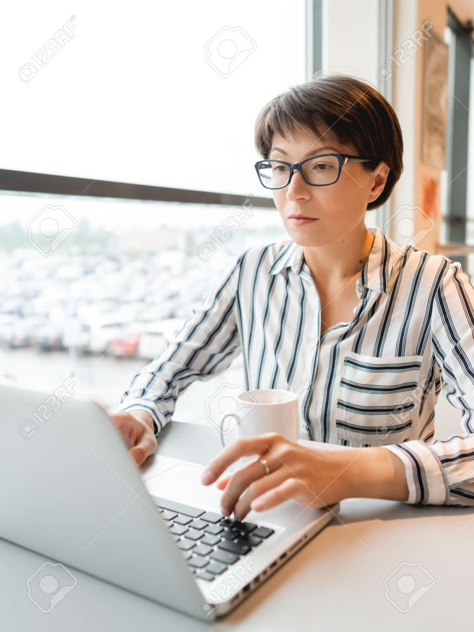 Business woman works with laptop in co-working center. Workplace for freelancers in business center. - 172806626