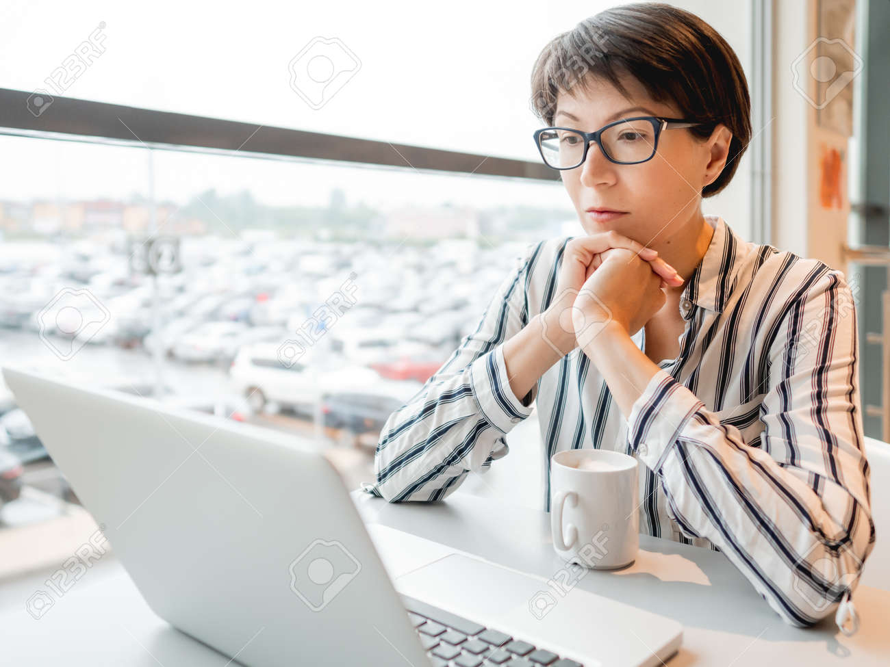 Business woman works with laptop in co-working center. Workplace for freelancers in business center. - 172806629