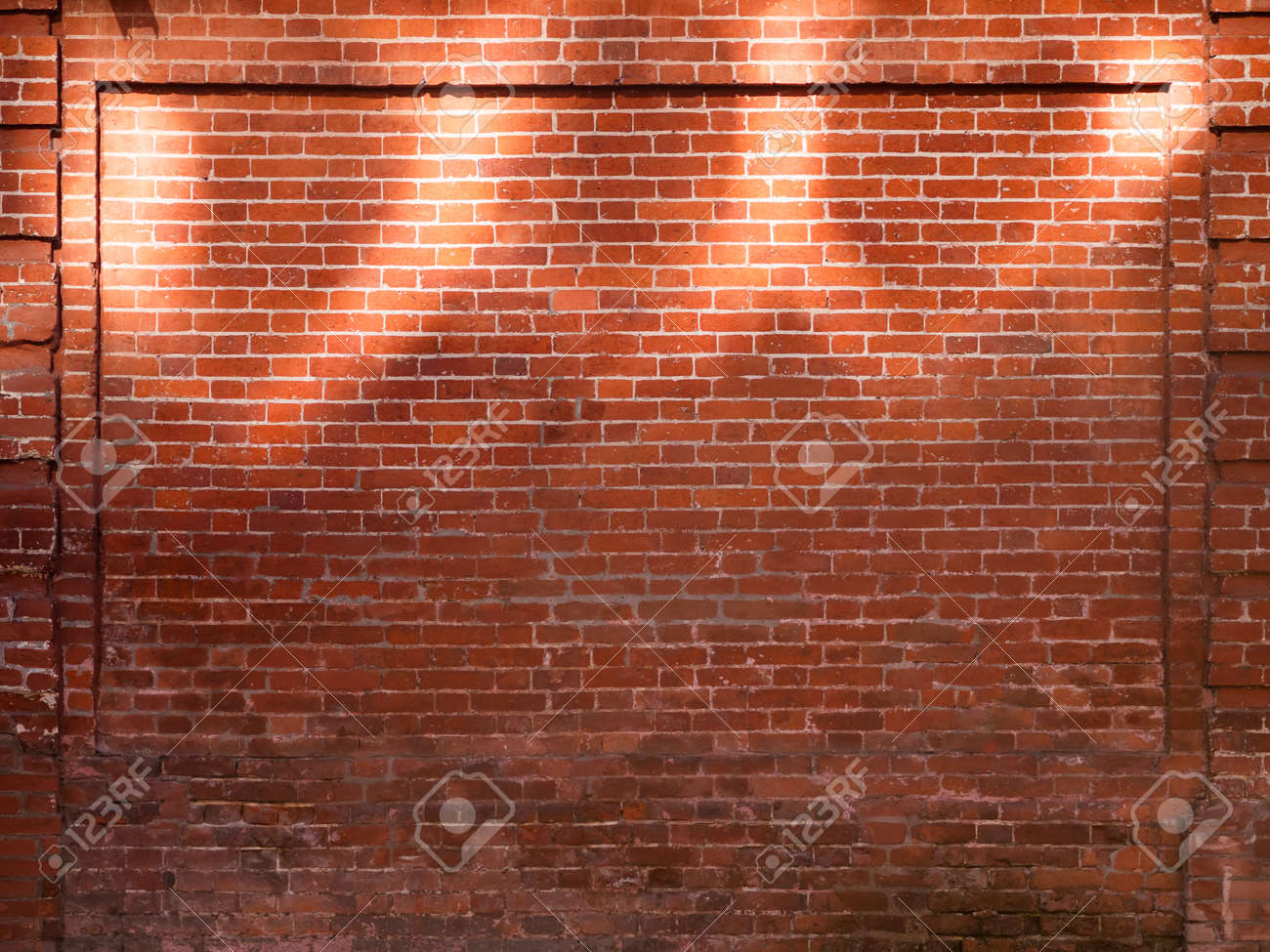 Red brick wall with sunbeams. Old wall with sun reflections at upper part. Old building with shabby surface. Mock up. - 172455577