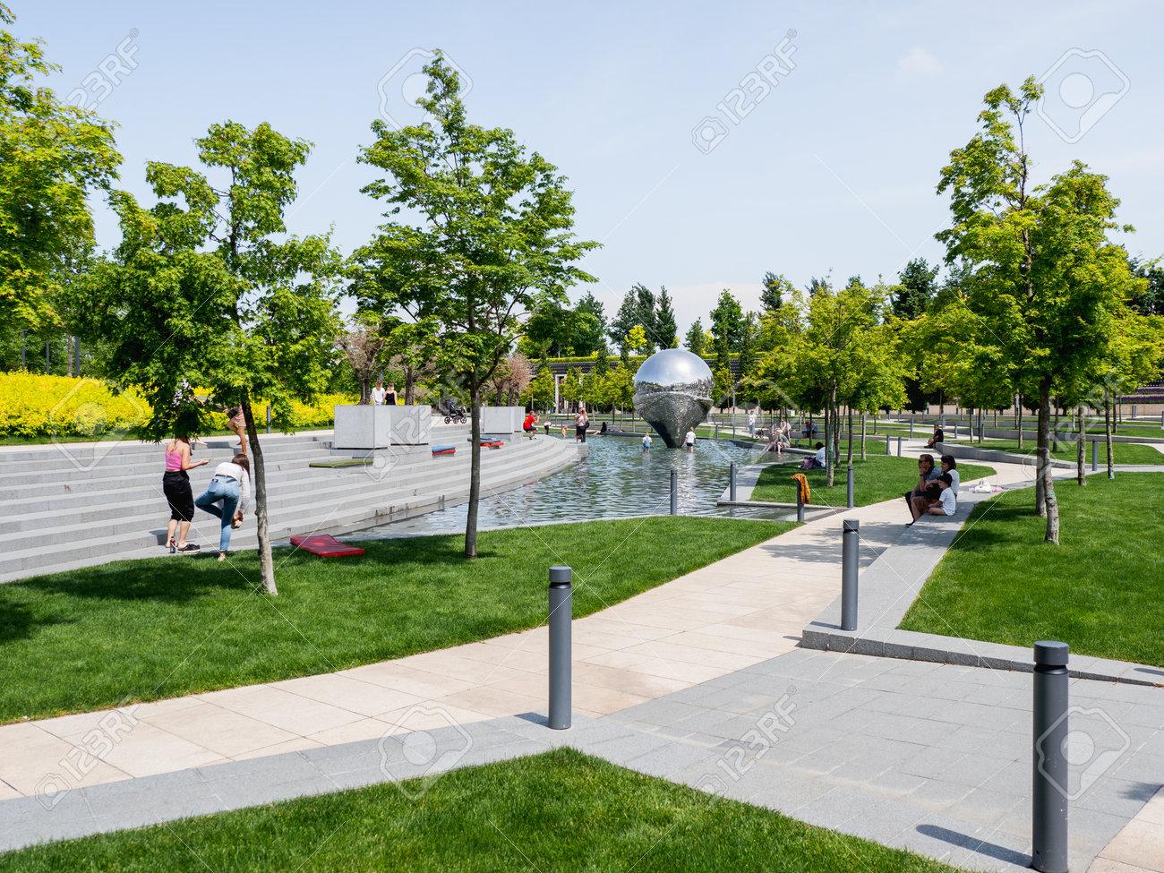 KRASNODAR, RUSSIA - June 01, 2021. People relaxes near fountains and lawns in famous Krasnodar urban park. - 173017793