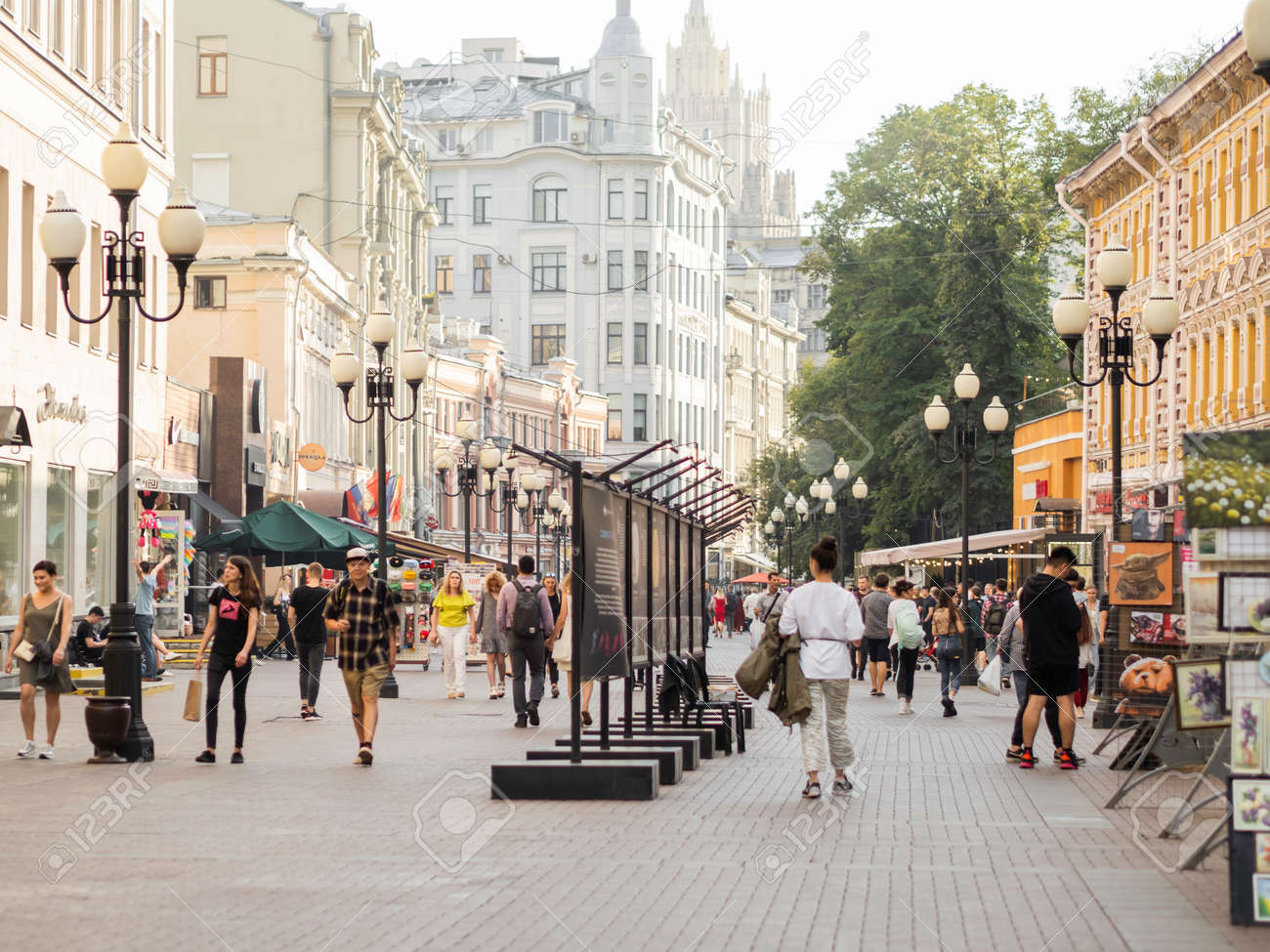MOSCOW, RUSSIA - August 08, 2021. Local people and tourists walk down famous Arbat street with souvenir shops and boutiques. - 173362708