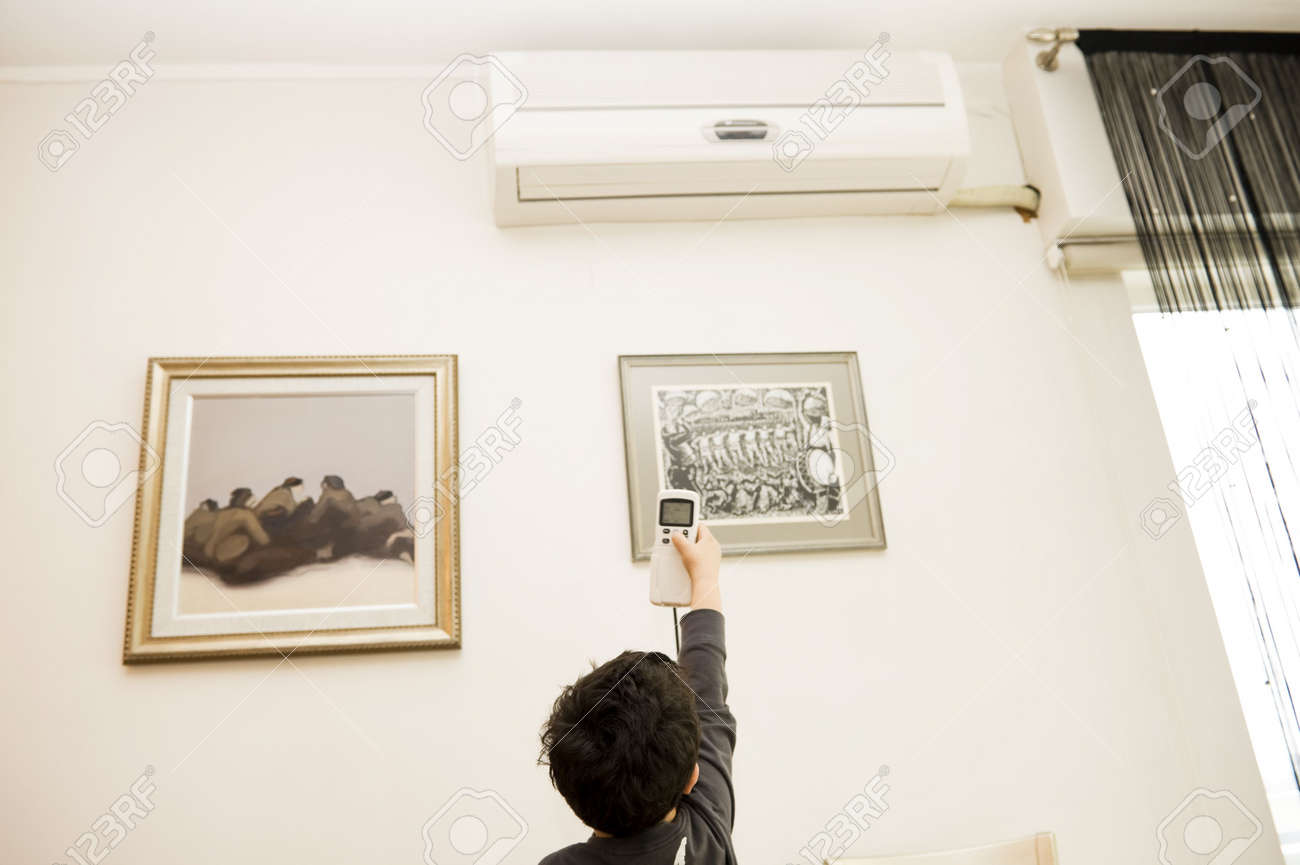 boy remote air conditioning Stock Photo - 4540960