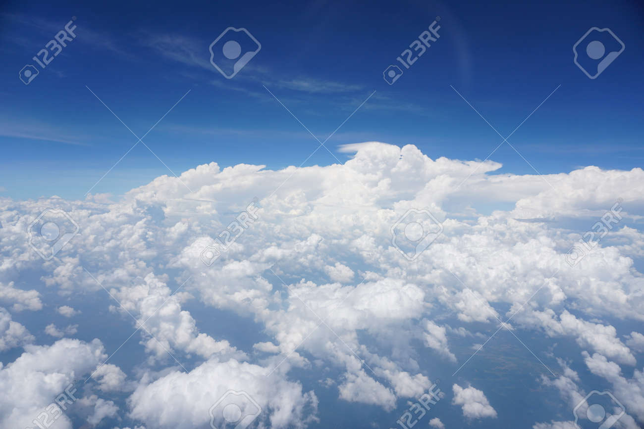 Clouds and sky as seen through window of an aircraft - 121086193