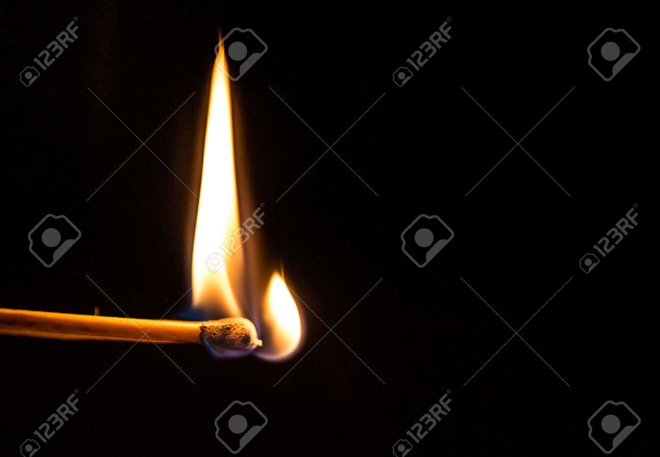 Burning match with a black background. Stock Photo - 18791260