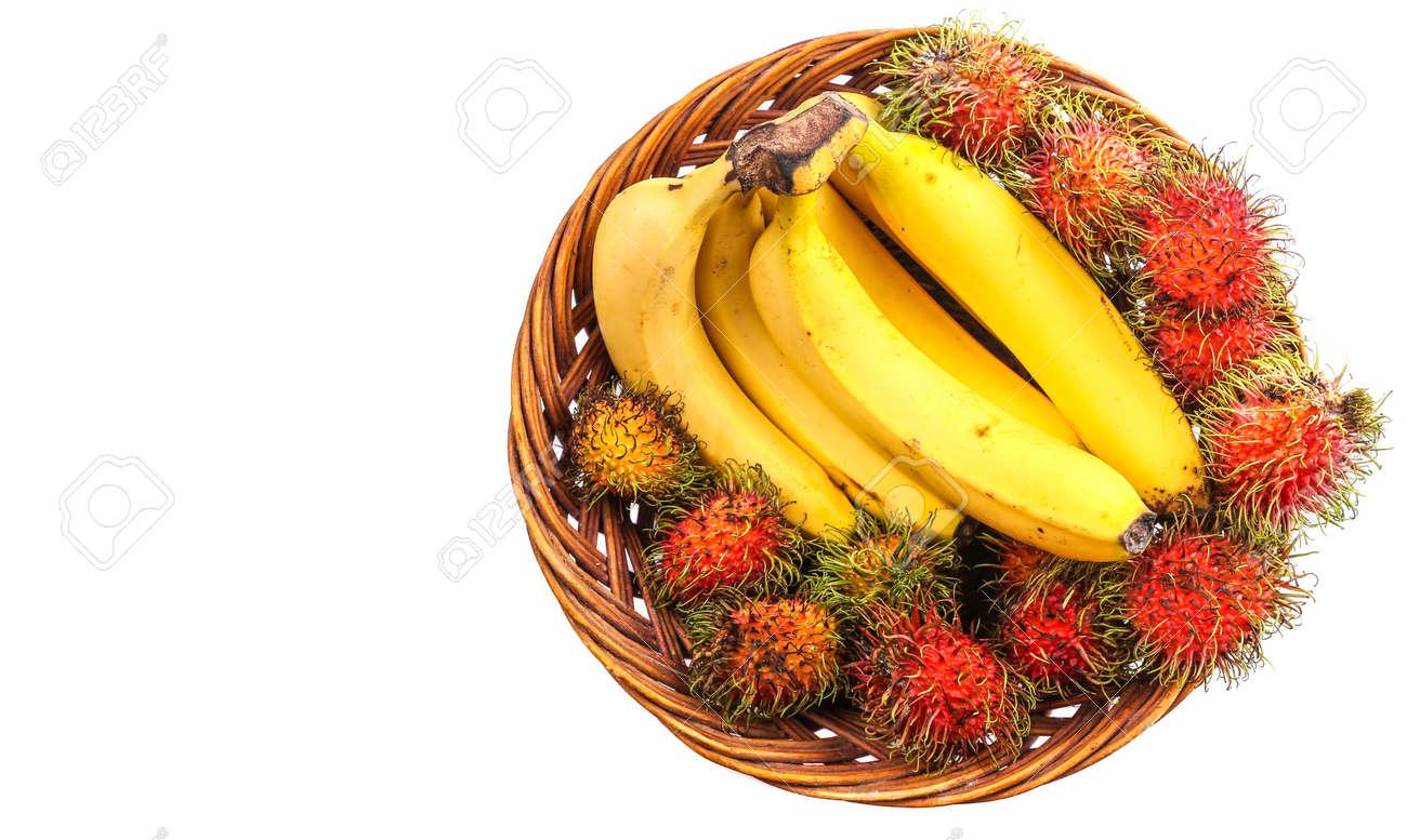 Banana and rambutan in a wicker basket Stock Photo - 24630540