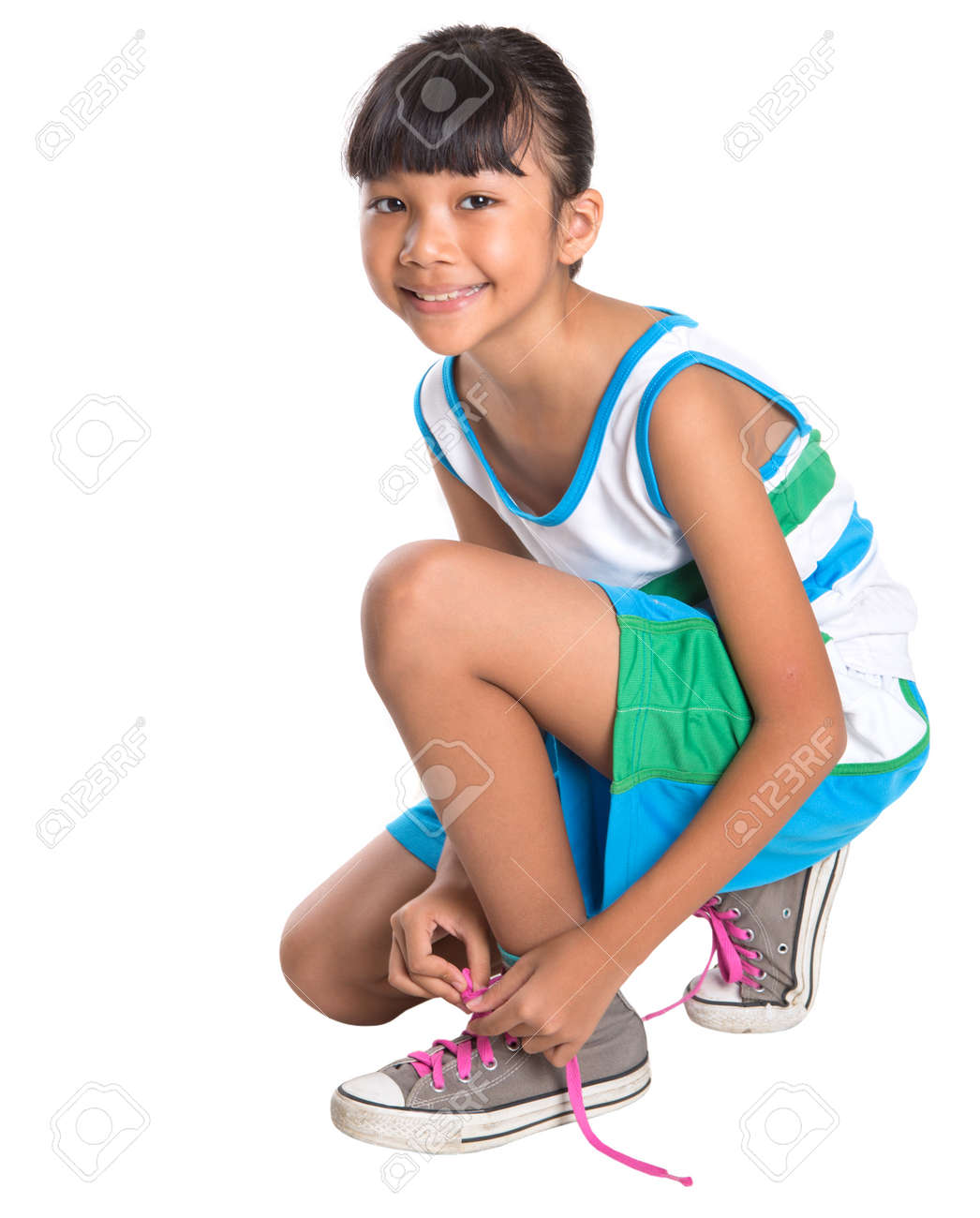 c0a9002015ba2 Young Girl With Athletic Attire Tying Her Shoe Laces Stock Photo ...