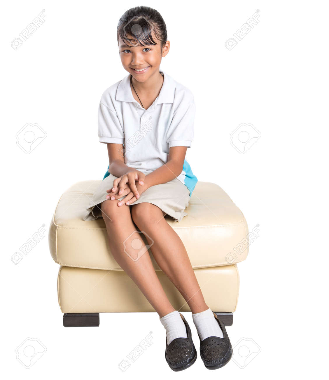Stock Photo Young Asian School Girl In School Uniform Over White Background