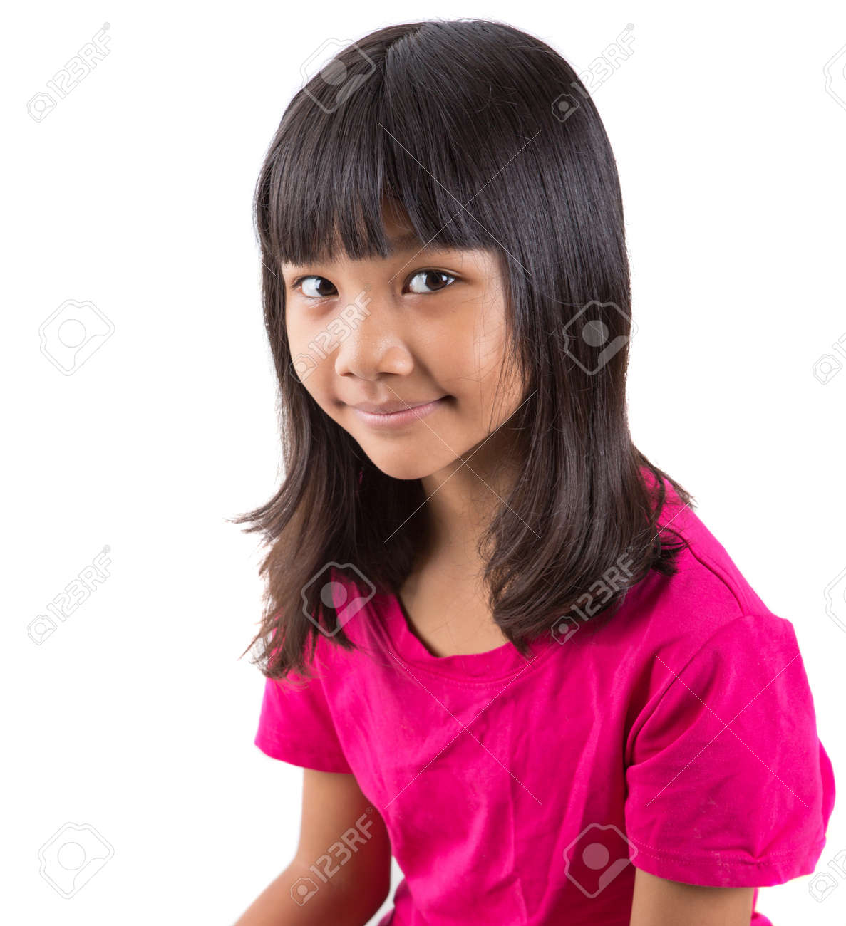 black preteen Young Asian preteen girl in pink t-shirt over white background Stock Photo  - 31374739