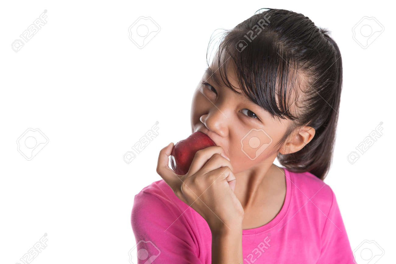 Stock Photo Young Asian Teen Girl Eating A Red Apple Over White Background