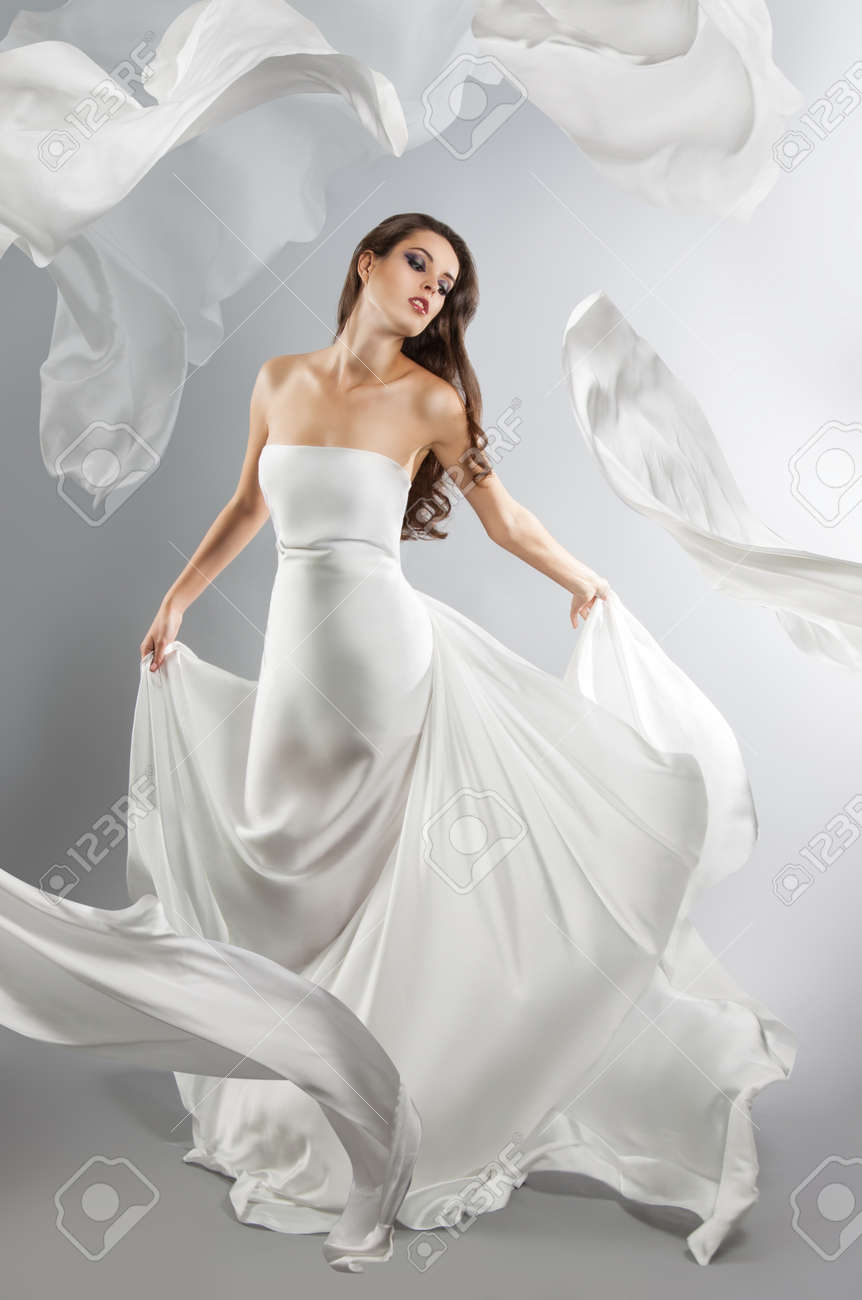 7cec7402e8 beautiful young girl in flying white dress. Flowing fabric