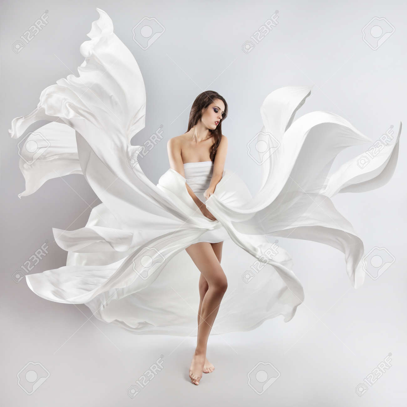 Beautiful Young Girl In Flying White Dress. Flowing Fabric Stock ...