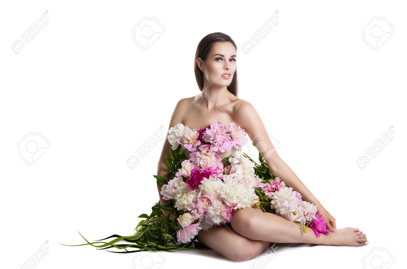 Beautiful girl with flowers peonies portrait of a young woman beautiful girl with flowers peonies portrait of a young woman with flowers in her hair dhlflorist Gallery