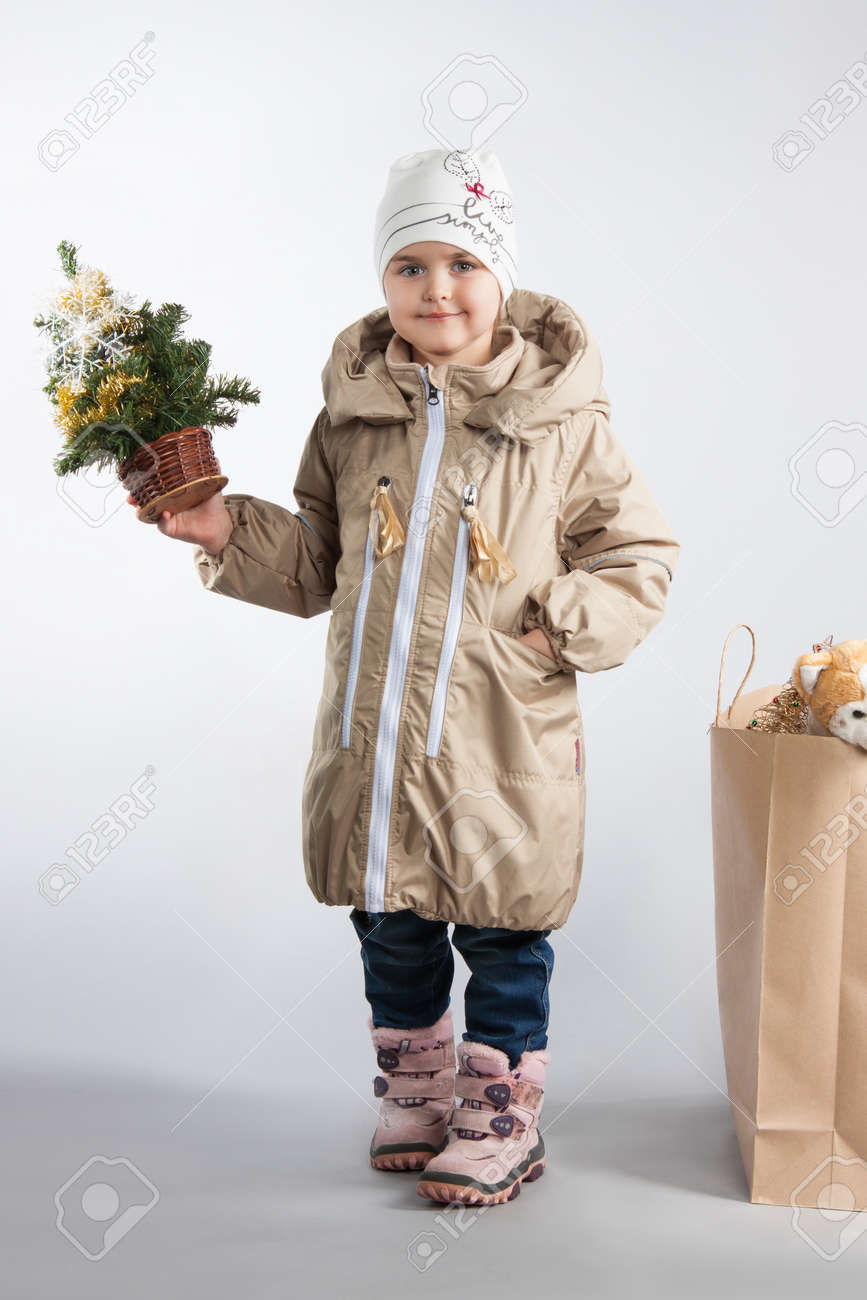 95891b869796 Cute Little Girl In Winter Clothes In Studio. Girl With A Bag ...