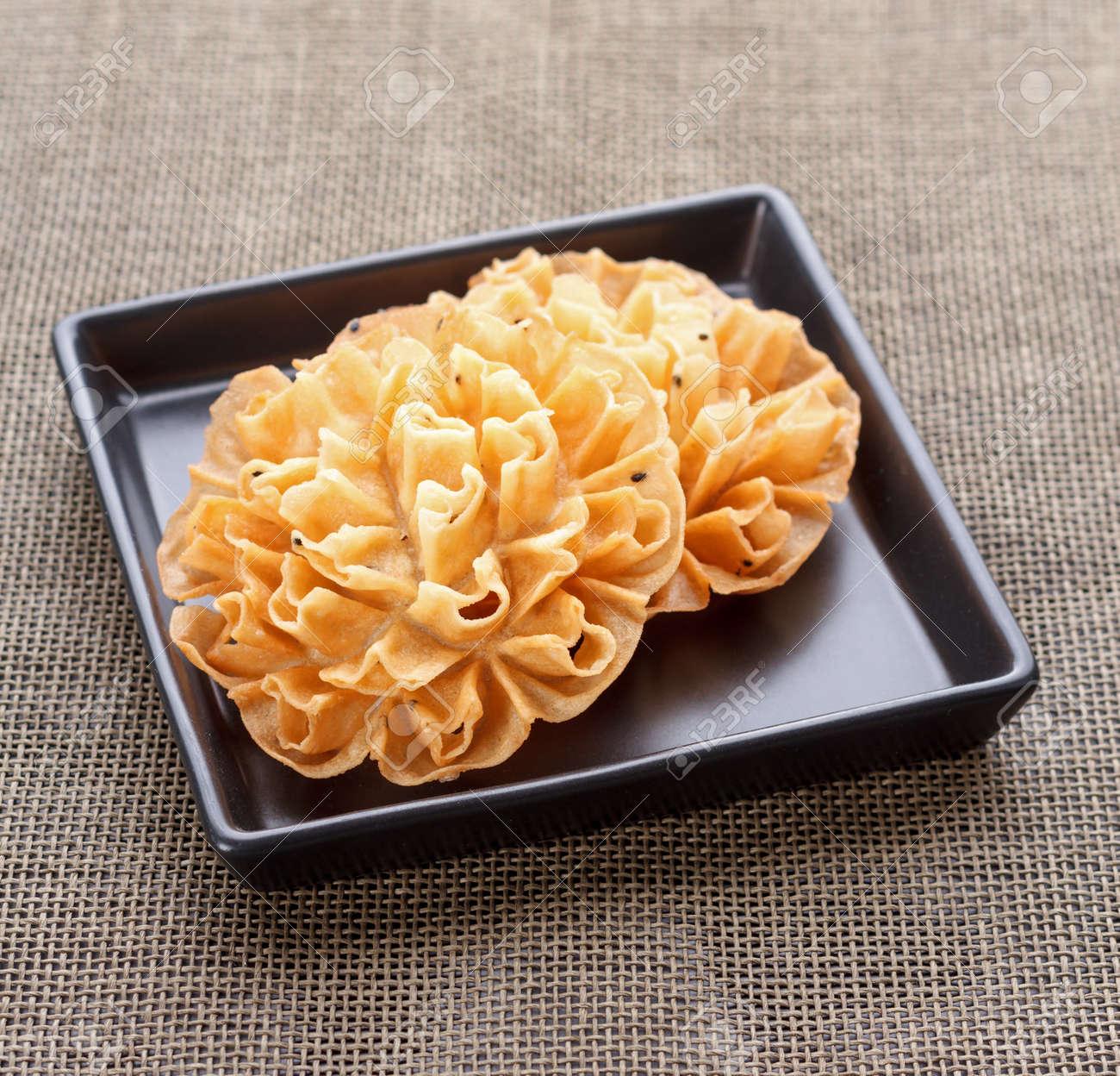 Crispy Lotus Blossom Cookie On Black Dish Dok Jog In Thai Stock