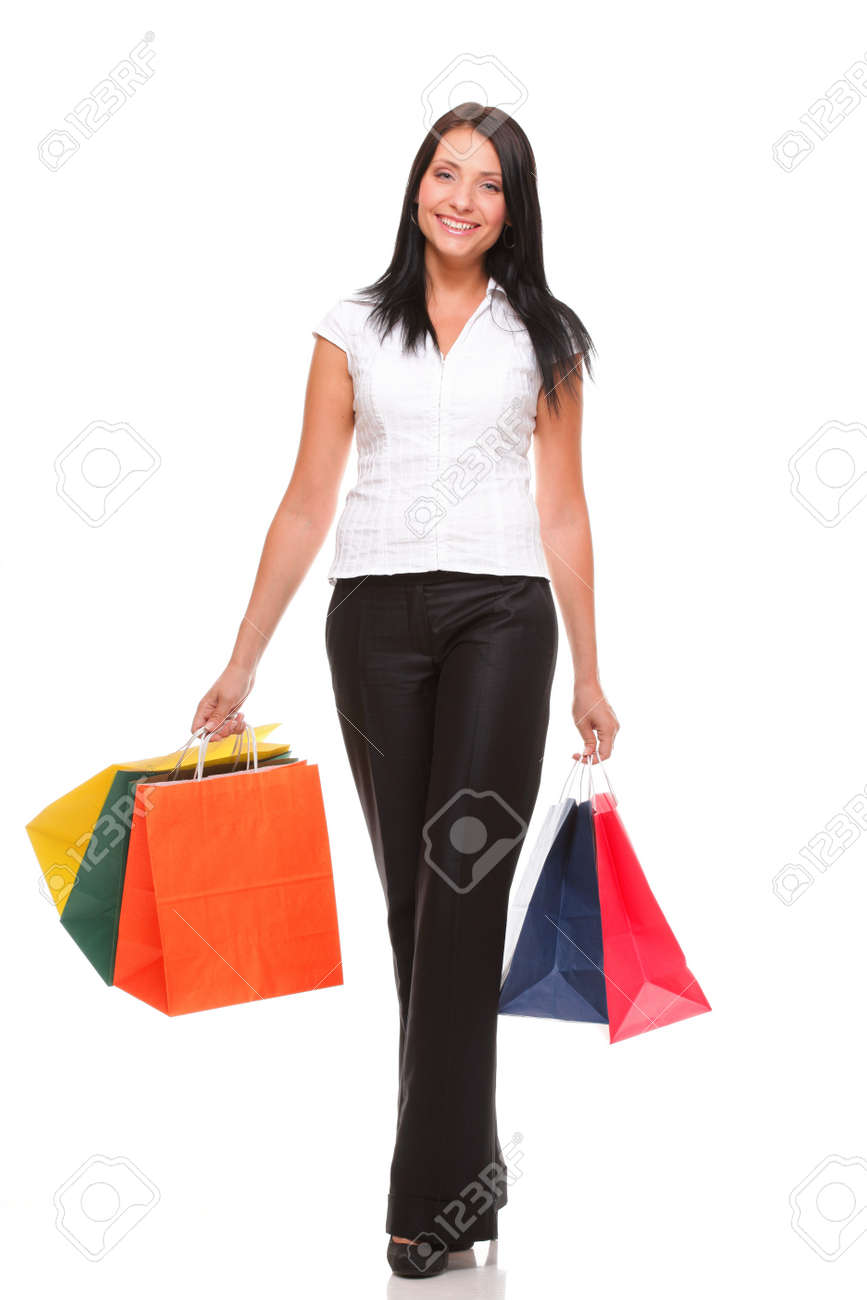 Portrait of young woman carrying shopping bags against white background Stock Photo - 14785603