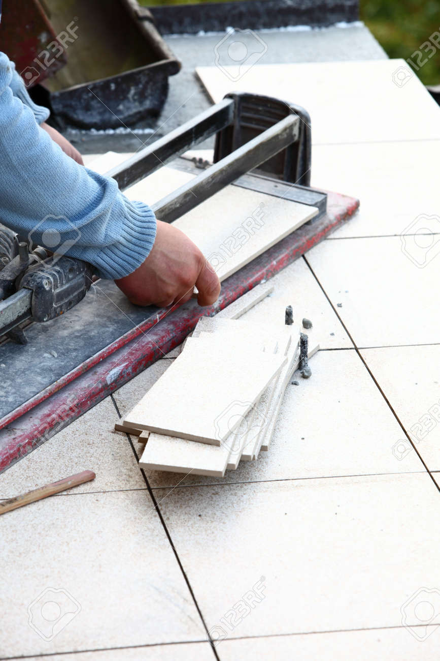 man cutting tile by cutter worker Stock Photo - 15540531
