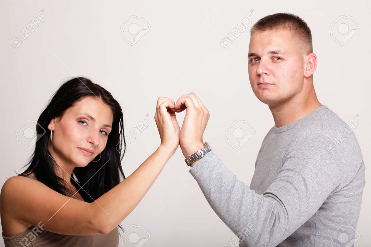 young in love Portrait of a beautiful young happy smiling couple young heart hand Stock Photo - 16729138