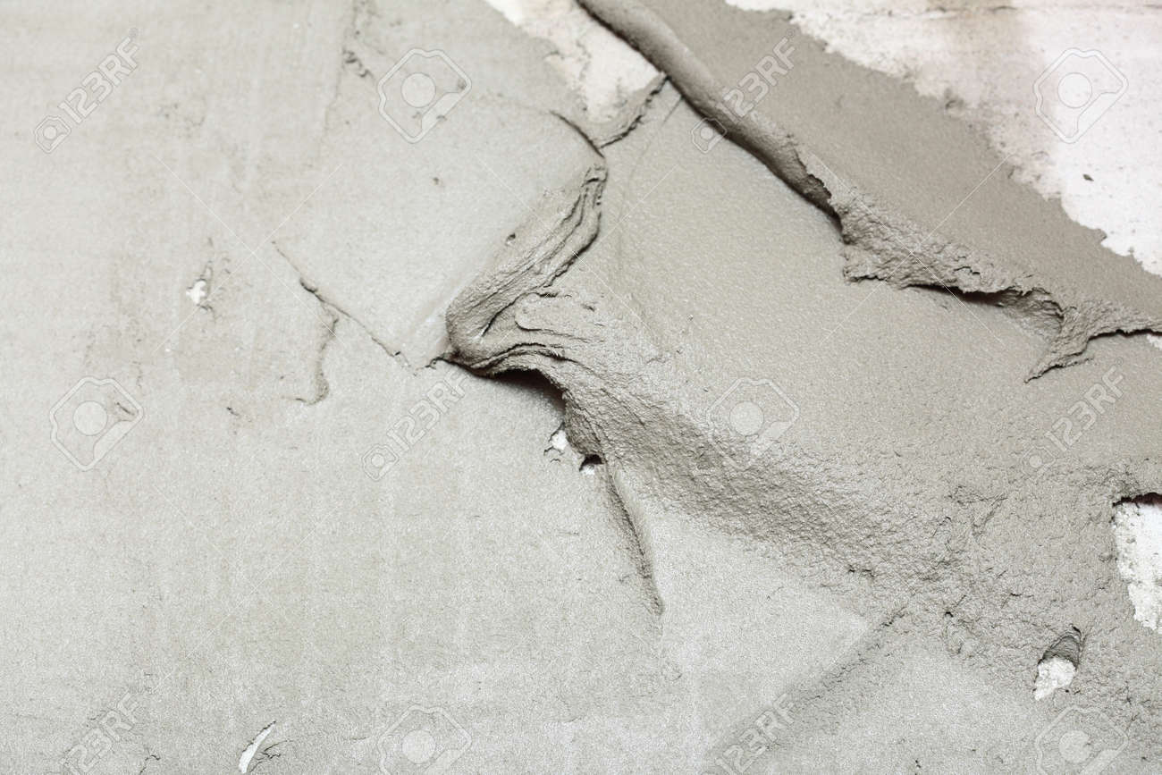 Construction worker is tiling at home, tile floor adhesive Abstract plaster stucco wall Stock Photo - 17157142