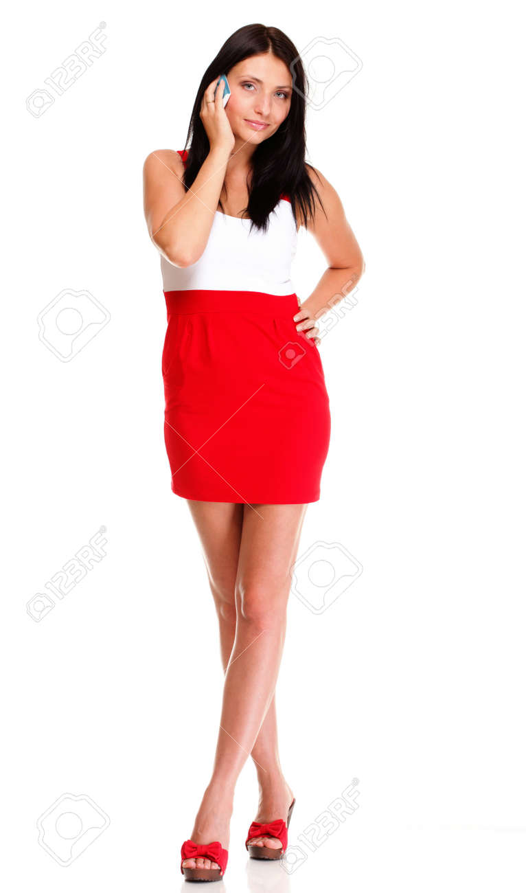 Full length of woman walking talking on mobile phone isolated on white background Stock Photo - 17687329
