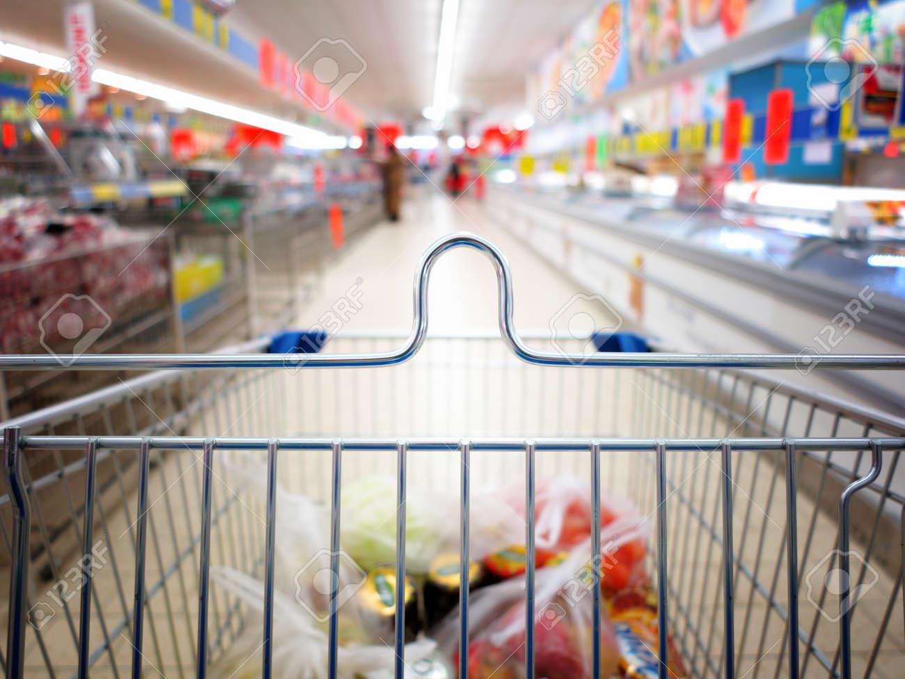 view of a shopping cart with grocery items at supermarket  blurred background Stock Photo - 17742543