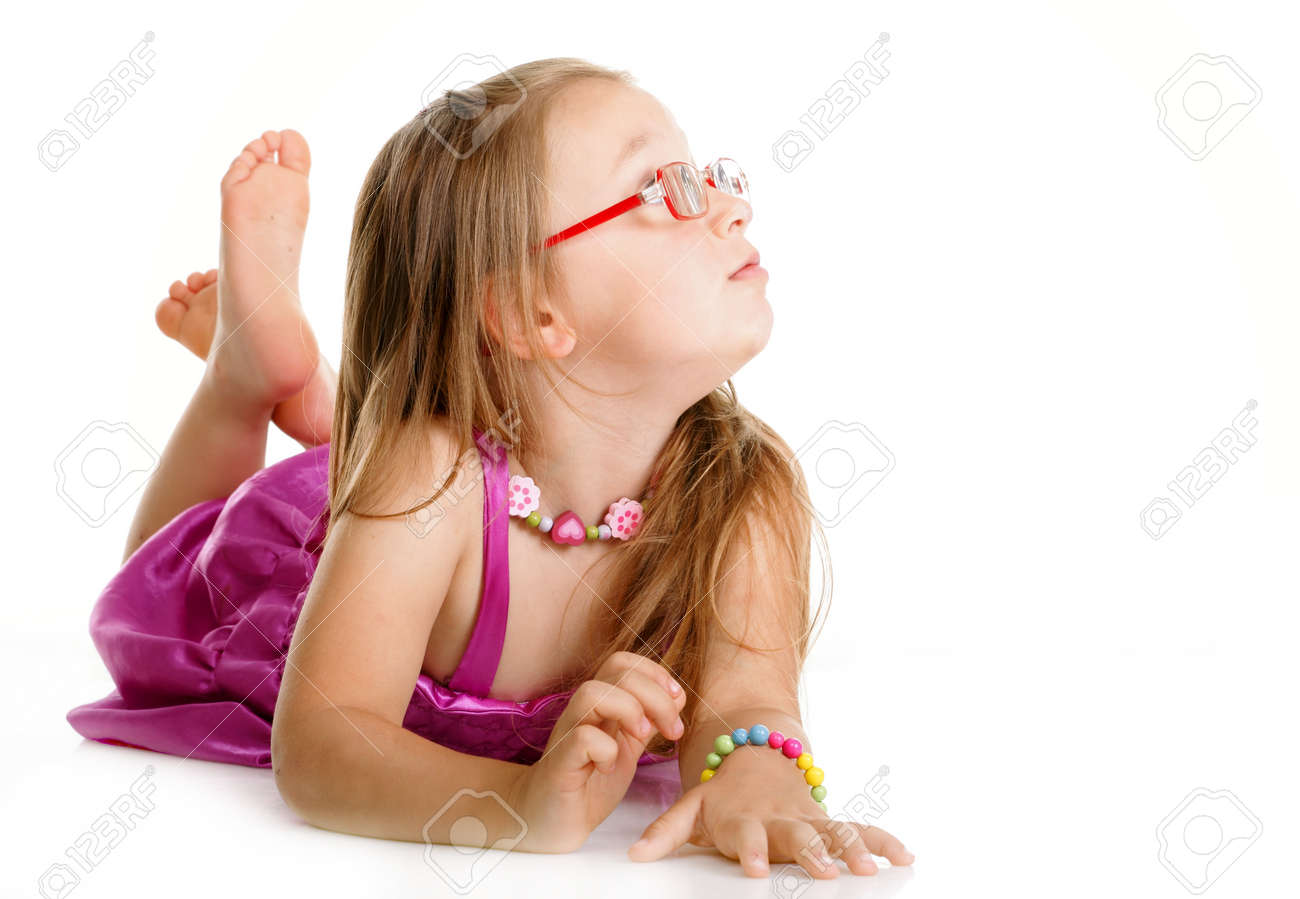 Little girl in glasses laying on floor looking to the side isolated over white Stock Photo - 17726018