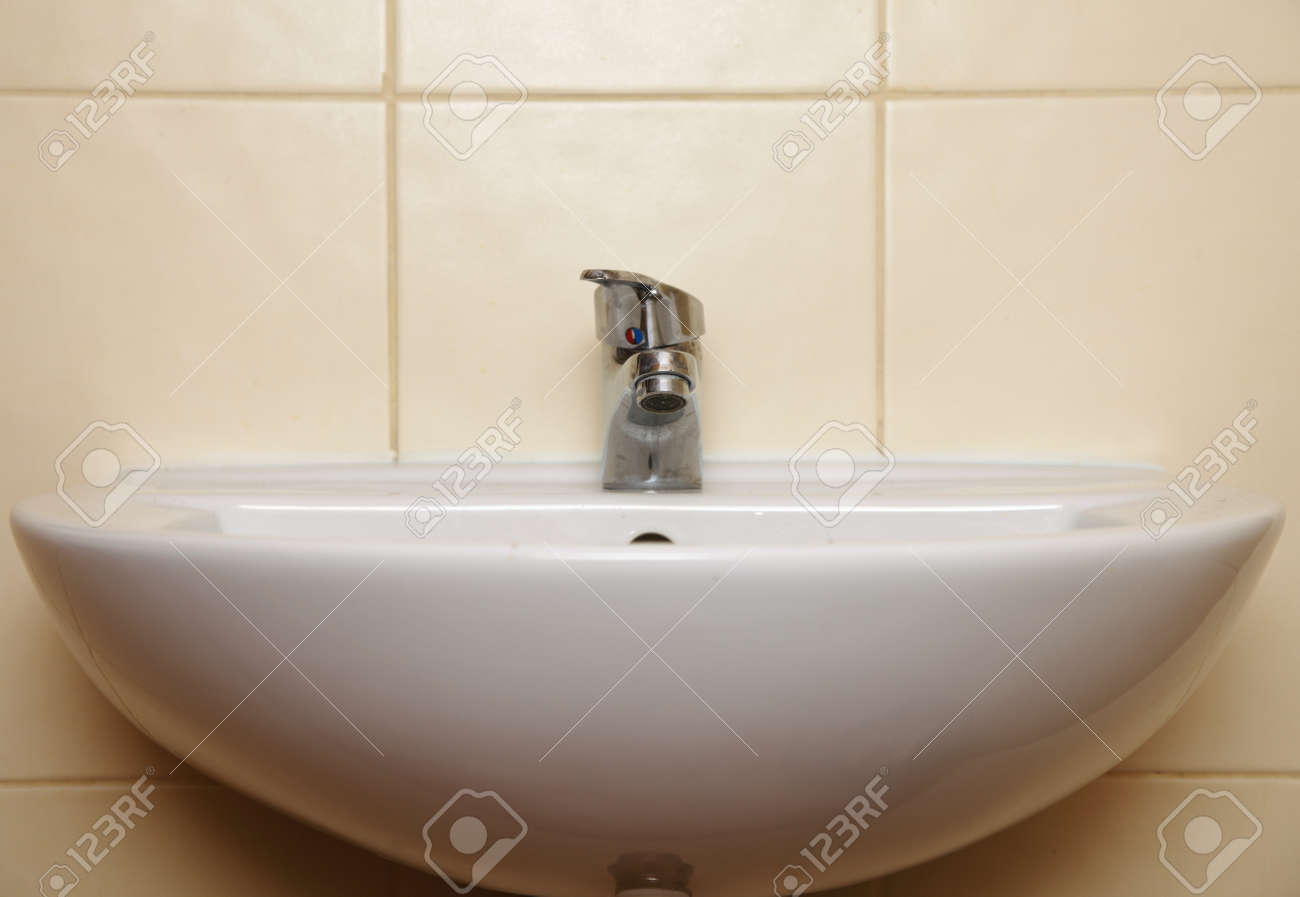 stock photo white sink and tap in the bathroom public toilet h38 sink