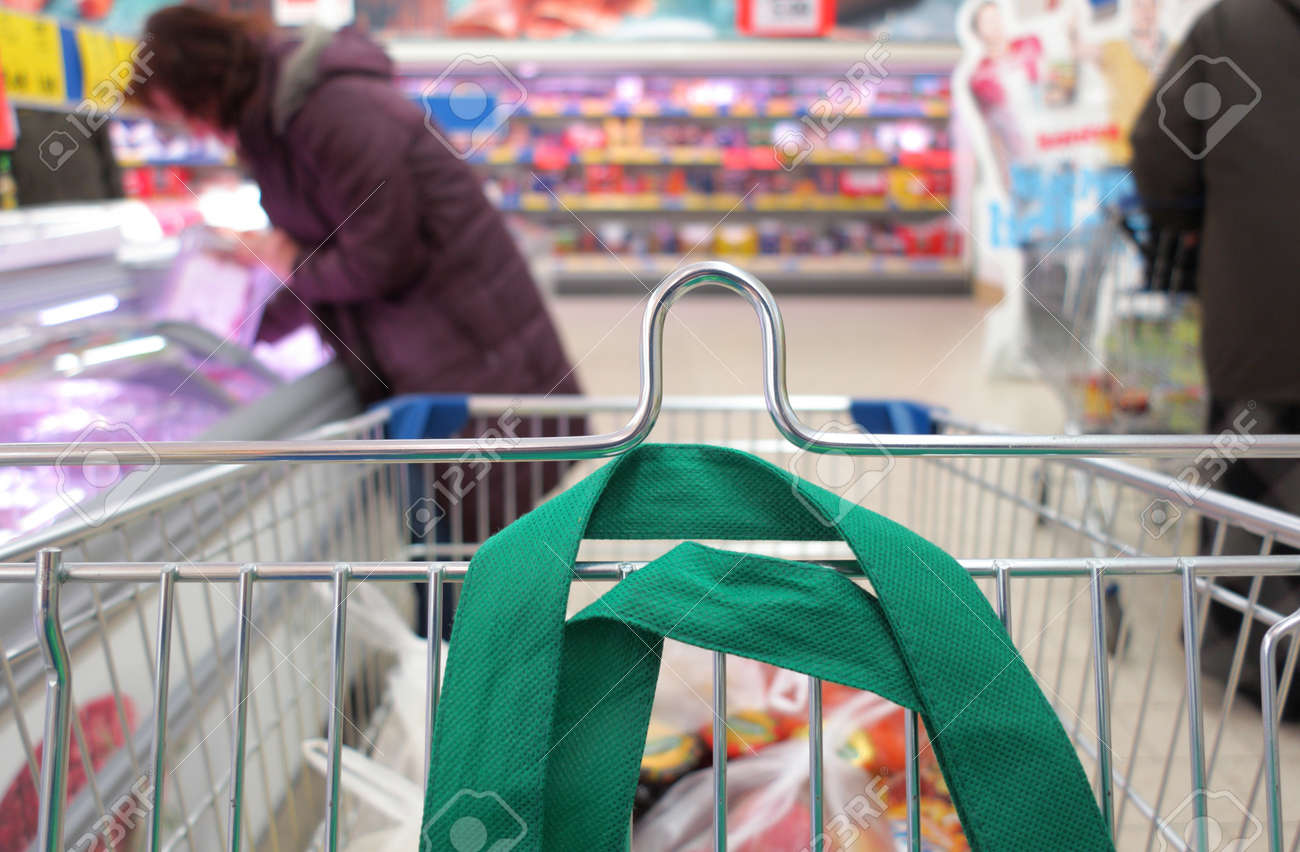 Woman shopping at the supermarket with trolley Stock Photo - 18141634