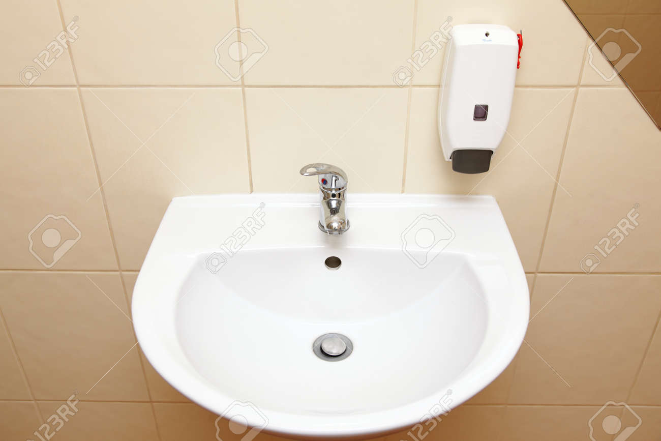 White sink tap and liquid soap in the bathroom Stock Photo - 18211074