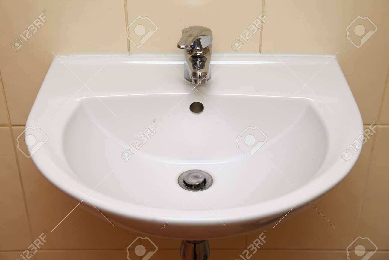 White sink and tap in the bathroom or public toilet Stock Photo - 18511443