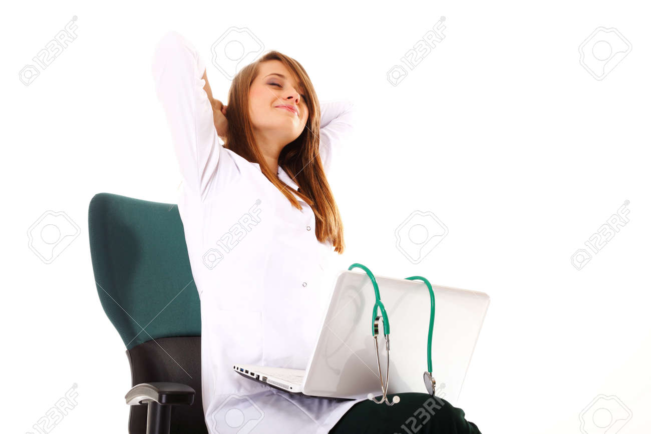 Female doctor working on her laptop stretching at her workplace against a white background Stock Photo - 18905863