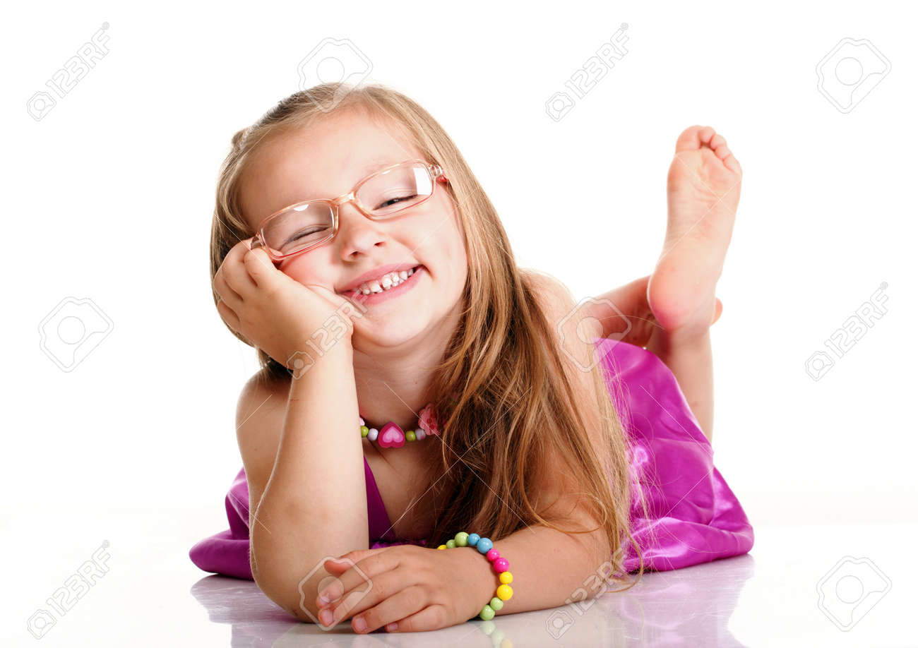 little girl lying cheerful little girl glasses funny is lying isolated on the white  background Stock Photo - 19054399
